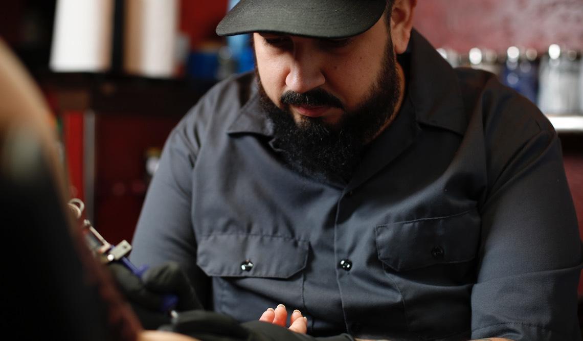 Dave Sedano creating a tattoo at Hart & Huntington Tattoo Co. Orlando