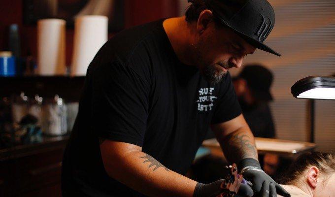 Adam Natonio creating a tattoo at Hart & Huntington Tattoo Co. Orlando