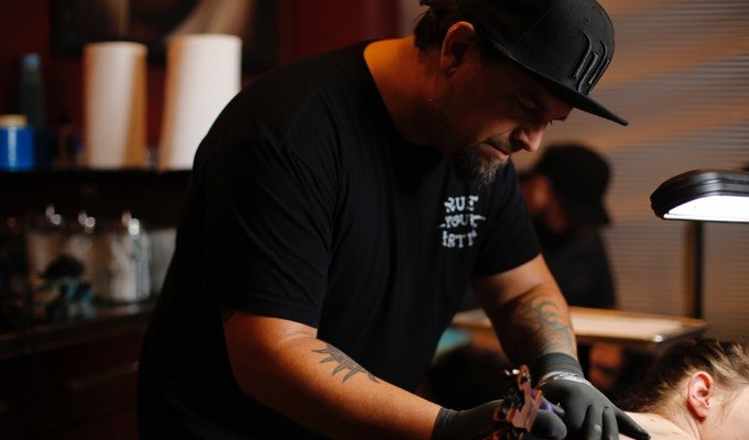Adam Natonio creating a tattoo at Hart & Huntington Tattoo Co. Orlando