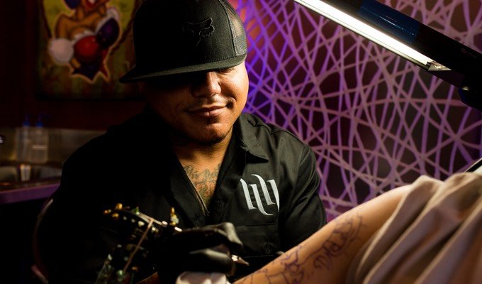JC tattooing a client